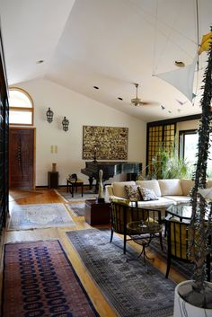 Oriental Rugs cover the wood floors for a bohemian touch
