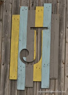 Nifty recycled wood monogram.