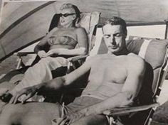Marilyn and Joe DiMaggio at the Tides Hotel & Bath Club in North Redington Beach, Florida, 1961.