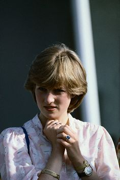 July 26, 1981: Lady Diana Spencer watching her fiance, Prince Charles at the Imperial International Polo Match at the Guards Polo Club, Windsor.