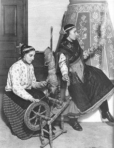 Hungarian spinners and spinning wheel, circa 1930.