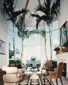 Amazing Living Room - love the palm trees indoors.