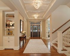Side staircase, vaulted ceilings, clean colours and beautiful chandalier lighting
