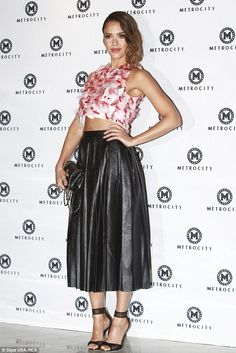 Stunning:Jessica Alba dazzled at the Metro City Fashion Show in an elegant floral print crop top, which she teamed with a high-waisted pleated leather skirt