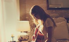 There's something so tranquil about a girl sitting on her bed and quietly playing the guitar. How peaceful. Love this.