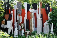 Sculpture can provide a great focal point or disguise a boring fence.