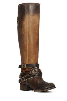 If you're a professional ass kicker, you need this boot. It's a knee-high boot made in distressed leather with a low stacked heel, strap detail, and rusted chain, buckle, and decorative hardware. Back zip closure. It's everything you love about a vintage boot, but it's brand spanking (or kicking, whichever you prefer) new! Looks awesome with a long white dress or over your skinnies.