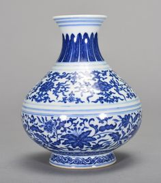 Qing Dynasty. The vase is wide globular-shaped. The exterior is decorated with blue ruyi clouds, long blue leaves with connective vines, blue lotus with buds, and many imperial designs. The bottom is decorated with Chinese characters. 8 3/16 in. tall.
