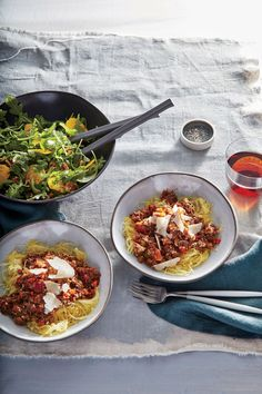 Mushroom Bolognese over Spaghetti Squash | We swap traditional pasta for gluten-free spaghetti squash in this meatless main. Roasted until tender and scraped with a fork, the squash comes apart in noodle-like strands that hold the sauce well. Roast an extra squash, scrape out the flesh, and store in ziplock plastic bags for a quick side during the week. A blend of mushrooms—dried porcini and fresh cremini and button—mimic the texture of ground beef while adding plenty of savory depth.