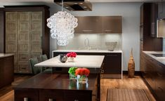Our modern kitchen remodel in Milwaukee - orb pendant, euro cabinets www.remodelwithsaz.com