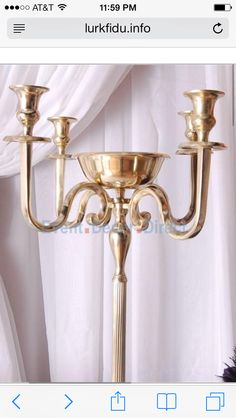 "This is a good Candelabra style in gold. The centre is a small ""bowl"" style that's big enough to support some flowers"