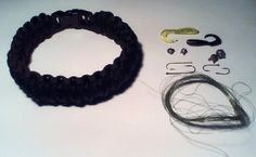 A 550 paracord fishing gear bracelet. Braided into this bracelet are two fishing lures, four lead weights, four fishing hooks and 20 ft of Spider Wire fishing line. (Seen on the right of the image.) By Paracordable.