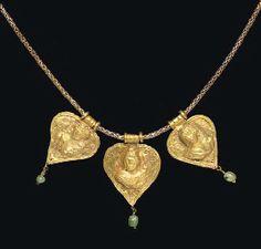 THREE ROMAN GOLD AND EMERALD PENDANTS CIRCA 2ND-3RD CENTURY A.D.