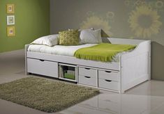 modern white wood daybed with storage and white fitted cover in sunflower pattern walls is very attractive in clean ceramic floor Home, Daybed, Flooring, Furniture, House Flooring, Daybed With Storage, One Bedroom, Floor Design, Multifunctional Furniture