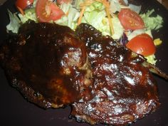 Homemade BBQ sauce on my special spiced pork chop and a side of salad.