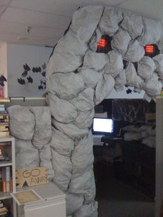 """best office EVER. giant skull with glowing red eyes and bats. love the sign that says """"go away"""" but it should be bigger and on a jagged edged weathered piece of wood."""