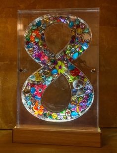 The lucky 8! 40cm high on 28cm width Plexiglass on wooden stand with led lighting 1200$