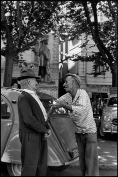 © Henri Cartier-Bresson/Magnum Photos FRANCE. Bouches-du-Rhone. Arles. 1959. In the rear, statue of the poet Frédéric Mistral.