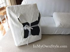 How to slipcover a couch & make it look custom- use a 1-piece slipcover for frame, then make tie-on cushion covers from a quilt!