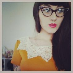 Very alluring photograph of girl wearing slanted reading glasses