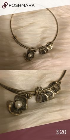 WEEKEND ONLY! Alex & Ani bangle Alex and ani bangle! Only seeing what I can get for it ! I'm moving this Monday and need to declutter my closet... Everything that is not sold by Monday will be donated or given away. My prices are already super cheap on everything I'm posting so no LOWBALLING. Alex & Ani Jewelry Bracelets