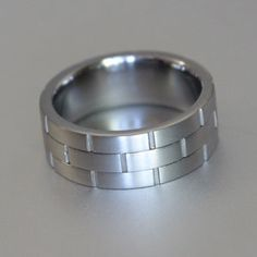 off centre groove-cut titanium ring Titanium Rings, Wedding Bands, Centre, Silver Rings, Engagement Rings, Bracelets, Jewelry, Enagement Rings, Charm Bracelets