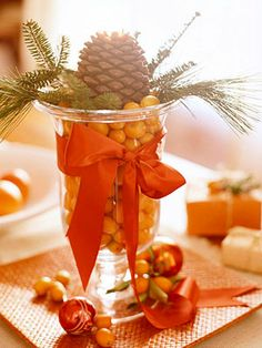 "kumquat centerpiece-I LOVE centerpieces such as this one- made with nature's produce...when the holidays are done- the centerpieces don't have to be ""Stored""...Best of all- the items can be found in the yard. or in those of neighbors..."