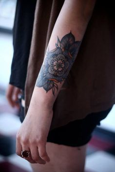 Flower on forearm #tattoo maybe with some type of compass/paisley incorporated?