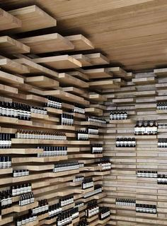 The walls, floor and ceiling of this store in Paris by Melbourne practice March Studio are covered by 3,500 pieces of wood.