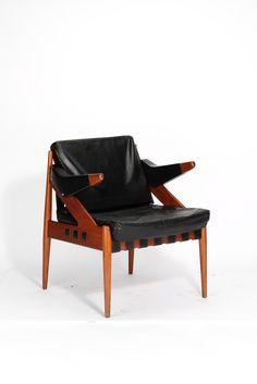Egon Eiermann; #SE 122 A Beech and Leather Armchair, c1958.