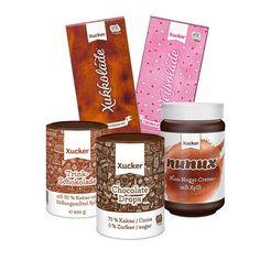 Xucker Genießer-Set - Die beliebtesten Schoko-Produkte von Xucker in einem Set. Xukkolade Vollmilch, Weißolade Erdbeer-Joghurt, Xucker Hot Chocolate, Xucker Chocolate Drops, nunux – Nuss-Nougat-Aufstrich. Nur mit Xylit gesüßt. GMO-frei. UTZ-zertifiziert.