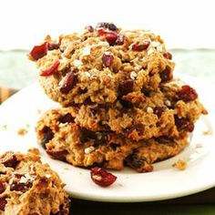 Nonstick cooking spray  1  large  banana, mashed (1/2 cup)  1/2  cup  chunky peanut butter  1/2  cup  honey  1  teaspoon  vanilla  1  cup  rolled oats  1/2  cup  whole wheat flour  1/4  cup  nonfat dry milk powder  2  teaspoons  ground cinnamon  1/4  teaspoon  baking soda  2/3  cup  dried cranberries or raisins