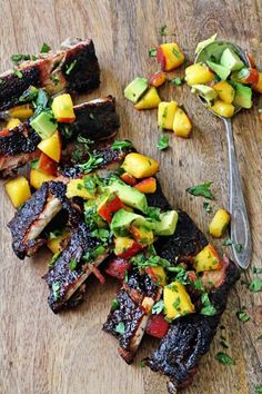 Throw these on your grill this weekend... Cumin Glazed Ribs with Peach Avocado Salsa!