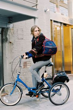 cara delevigne on a tricycle