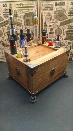 This hand-made box has 24 holes for Vaping enthusiast. Provencal Stain, Bronze Wolfs Head Corner Guards on each side, and Lions Claw Style Feet.
