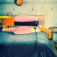 Colorful mix of bedding patterns - Via: kip & co