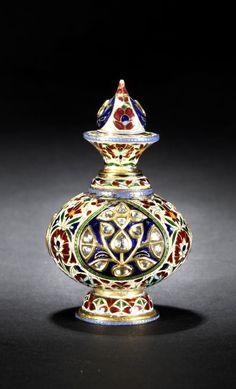 A fine Indian diamond-set enamelled gold Perfume Bottle.