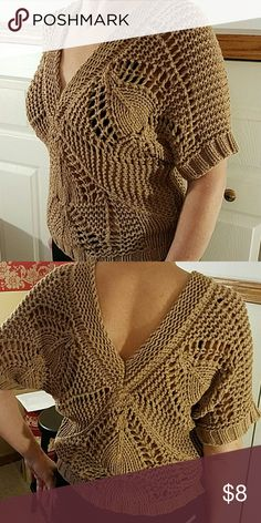 "Dark Camel Crocheted Dolman Sleeve Sweater The front and back plunge of this crocheted sweater will sit around your natural waistline.  Measures 21"" from the shoulder.  From Old Navy, this color is one that will go with practically anything.This sweaters pattern matches Candies skirt. (also listed) Old Navy Sweaters V-Necks"