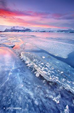 Sunset over Jökulsárlón Glacier Lagoon, South Coast, Iceland.