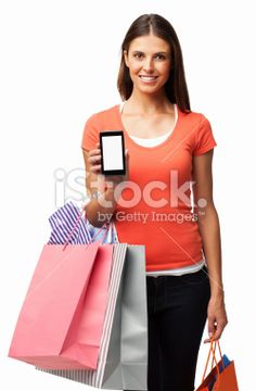 Woman With Shopping Bags Showing Smart Phone - Isolated Royalty Free Stock Photo