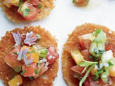 Chopped red, green and orange tomatoes are tossed with olive oil and herbs, then served on Parmesan tuiles. The result: a supremely colorful, incredib Heirloom Tomatoes, Appetizer Dips, Appetizer Recipes, Chefs, Chef Jobs, Cauliflower Soup, Tomato Salad, Roasted Tomatoes