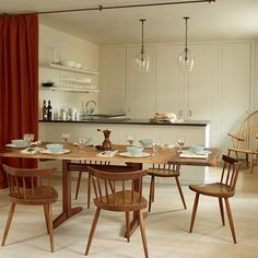 Kitchen Dining Room with Dividing Curtain. Kitchen and dining area separated by a smart red curtain to create two separate spaces. Interior design ideas and inspiration from HOUSE by House & Garden.