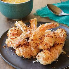 Coconut Shrimp with Fiery Mango Sauce | CookingLight.com (so many recipes in which I could use coconut shrimp and I already have my canned mango salsa!)
