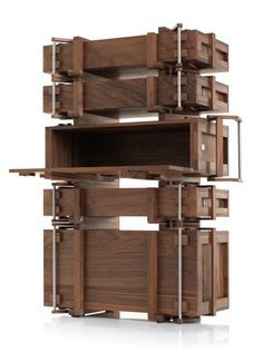 The Cabinet of Chests transforms 5 chests into a cabinet. Each lid in turn serves as a shelve or even a writing desk by Wouter Scheublin.