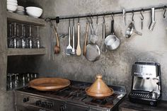 Kitchen with built in cupboard, all finished in grey tadelakt. Very chique. Riad La Maison in Marrakech.