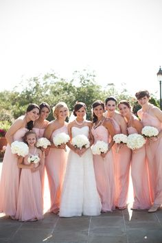 blush pink bridesmaids and white flowers.. I love the color on the bridesmaid dresses but the bridesmaid dresses are too much like the brides dress