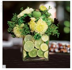 Green Flowers For center pieces | Sliced Lime and Flowers in Glass Vase Centerpieces | Budget Brides ...