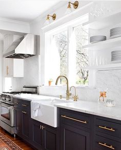 """One Kings Lane on Instagram: """"Marble countertops paired with dark base cabinets & brass accents. @elizabethlawsondesign, thanks for showing us the kitchen of our dreams!  ✨To see more of our fave spaces from Insta, head over to our *new* community page! Link is in our profile.✨ [: @jenniferhughesphoto] #myoklstyle #regram #kitchen #interiordesign"""""""