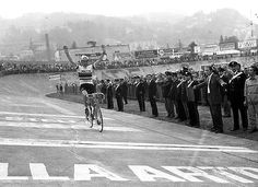 Merckx taking his 1971 Giro di Lombardia victory (in the rainbow bands of the World Champion) on what looks like the Velodromo Vigorelli  in Milano - but I can't be sure.