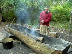 This is james from the Wampanoag nation , he is working on a Mashoon (canoe) at plimoth plantation museum.  I (Tim Turner) interview him in the Wampanoag Homesite about how the Wampanoag burning this log out with fire to make a boat.